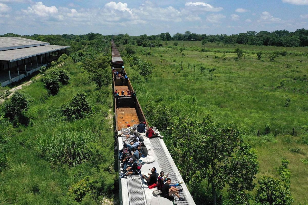 "A photo issued on July 30, 2019, shows an aerial view of migrants on a train known as ""The Beast"" in Palenque, Chiapas state, Mexico, on July 25, 2019. AFP"