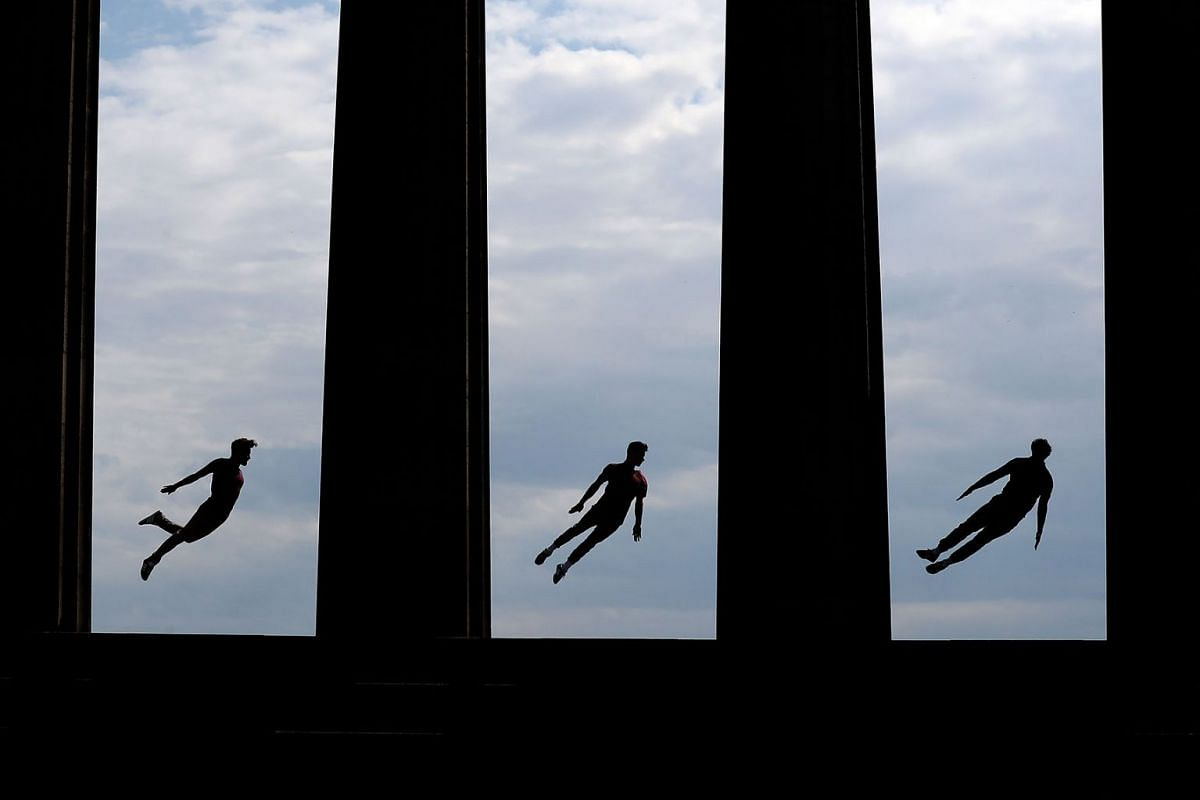 Acrobats Beren d'Amico, Louis Gift and Charlie Wheeller, from Barely Methodical Troupe perform on Calton Hill during Edinburgh Festival Fringe, 30 July 2019 in Edinburgh, Scotland. PHOTO: PA WIRE VIA DPA