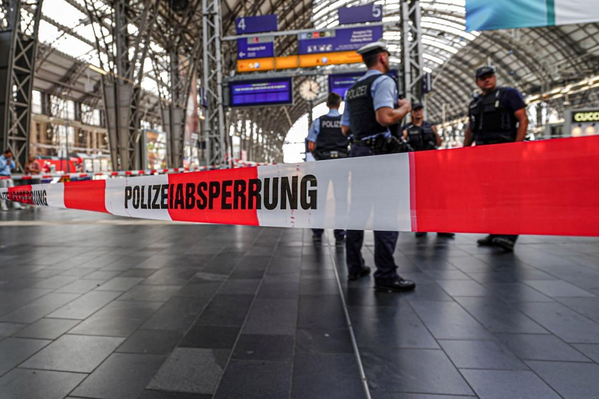Police officers cordon off areas near the platforms at the main train station in Frankfurt on July 29, 2019.