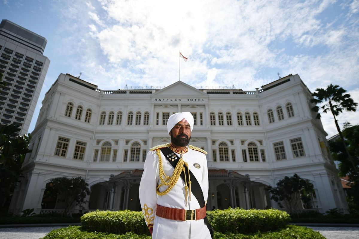 A photo issued on August 1, 2019, shows Raffles Hotel doorman Narajan Singh standing in front of the hotel on July 26, 2019, which opens today after a two-year-long facelift. He has been with the hotel since early 1992. PHOTO: THE STRAITS TIME/LIM YA