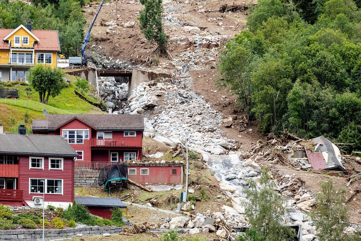 A picture taken in Joelster conty on August 1, 2019 shows damages near houses two days after mudslides. PHOTO: NTB SCANPIX/AFP