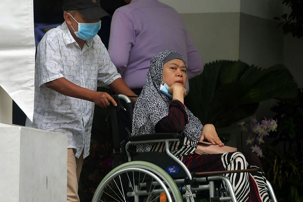 Zariah Mohd Ali and her husband Mohamad Dahlan, seen here leaving the State Courts on July 30, 2019, were dealt with in court on Thursday for abusing their maid. Zariah, 58, was sentenced to 11 years in jail, while her husabnd, 60, was sentenced to 1