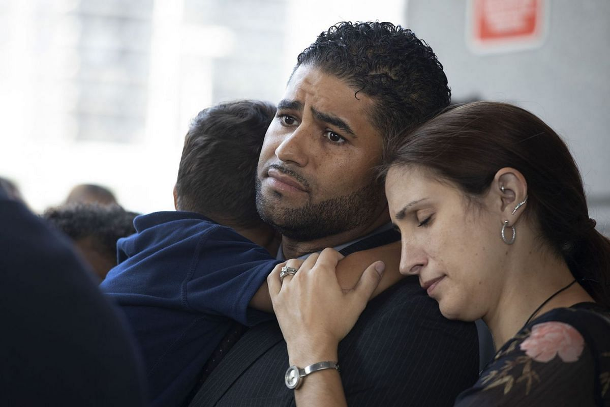 Juan Rodriguez, holding his son Tristan, leaves Bronx Criminal Court with his wife Marissa after a hearing, Aug. 1, 2019 in New York. Rodriguez has pleaded not guilty to manslaughter and other charges in the deaths of their 1-year-old twins left in a