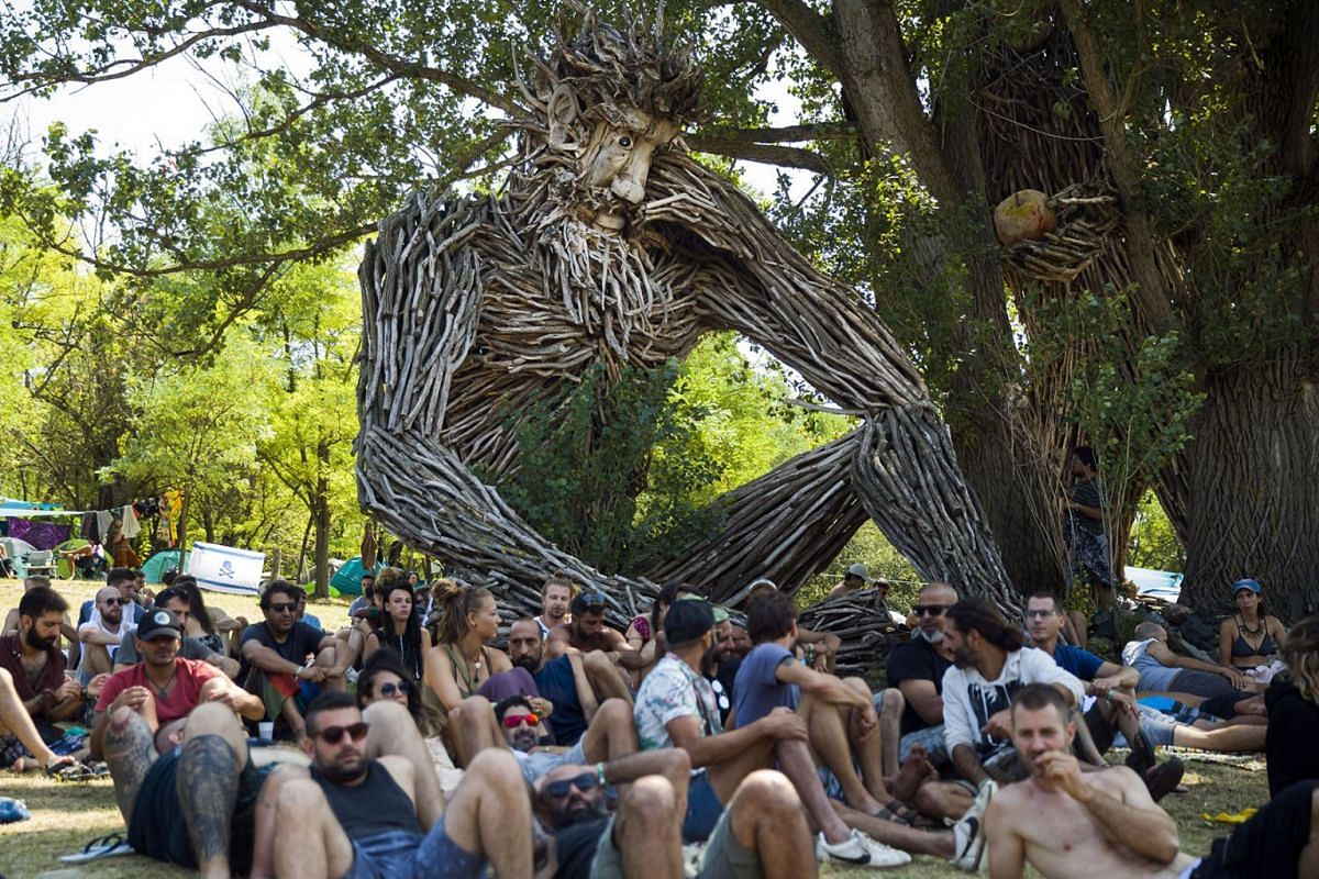 Revelers attend the seven-day O.Z.O.R.A. Festival, described by organizers as a 'psychedelic tribal gathering', near the village of Ozora, Hungary, August 1, 2019. PHOTO: EPA-EFE