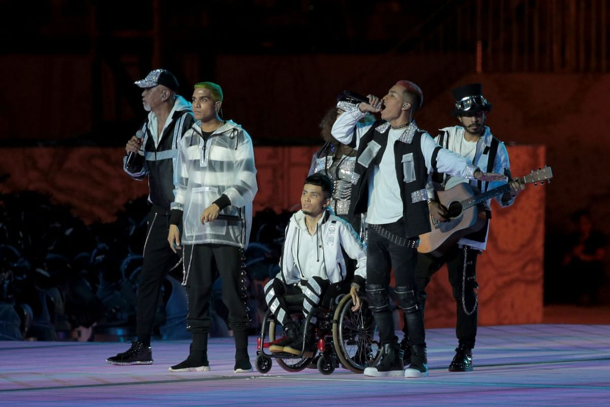 Rappers (front row, from left) Yung Raja, Wheelsmith and Fariz Jabba performing at the National Day Parade preview on July 27. The trio will be joined on Aug 9 by four other musicians in the rap and hip-hop segment - Bani Hidir, Beverly Morata, Mel F