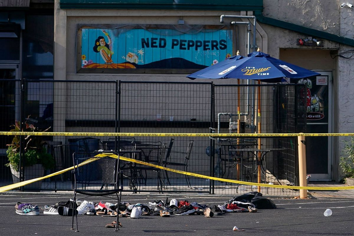 Shoes are piled in the rear of Ned Peppers Bar at the scene after a mass shooting in Dayton, Ohio, U.S. August 4, 2019. PHOTO: REUTERS