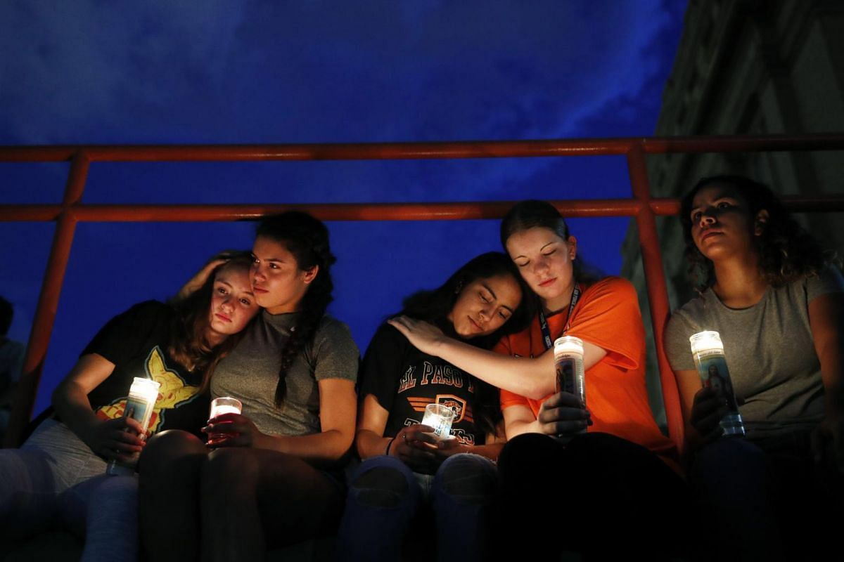 (From left) Melody Stout, Hannah Payan, Aaliyah Alba, Sherie Gramlich and Laura Barrios comfort one another during a vigil for victims of the deadly shooting in El Paso, Texas.