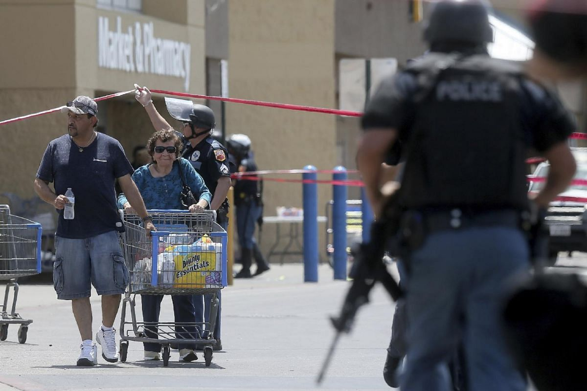 Customers being escorted from the Walmart store at the Cielo Vista Mall in El Paso, Texas, after a gunman opened fire on shoppers there.