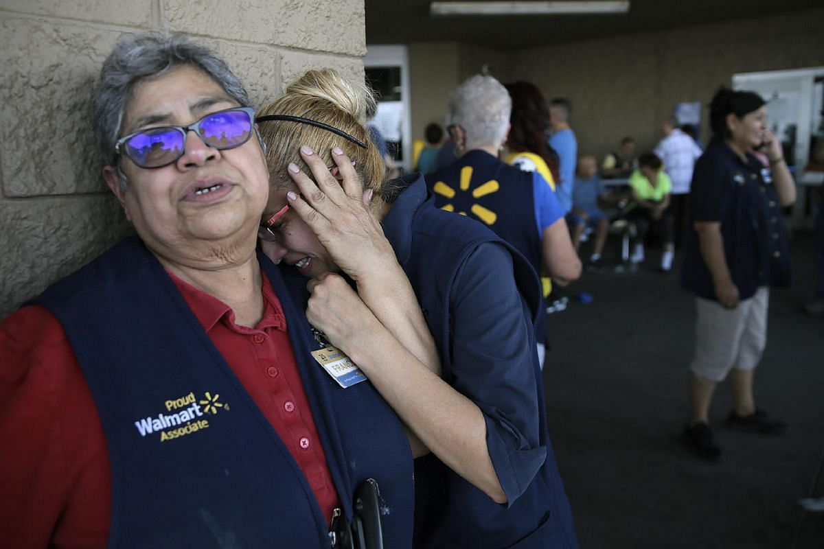 Walmart employees after the deadly shooting at their store on Aug 3, 2019, in El Paso, Texas.