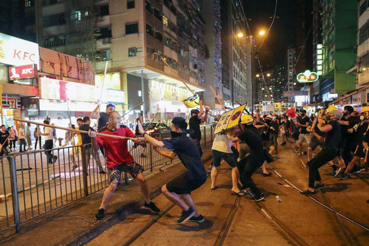 Skirmish between protesters and men armed with poles in Hong Kong's North Point on Aug 5, 2019. PHOTO: SOUTH CHINA MORNING POST