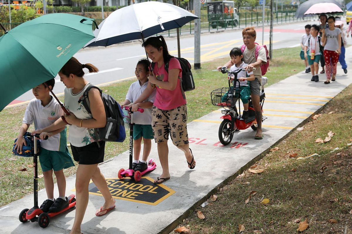 A trial of School Zone markings is being introduced to footpaths outside some schools, such as the one shown here at Fern Green Primary School in Sengkang, to remind personal mobility devices (PMD) users to slow down, Aug 5, 2019. PHOTO: THE STRAITS