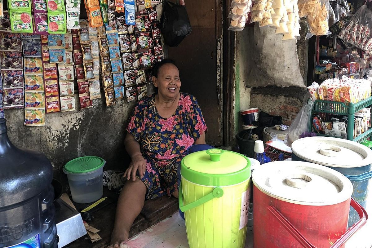 Ms Emo at her store in Muara Baru village, where she has been selling sweets and cigarettes for 40 years. ST PHOTO: JEFFREY HUTTON