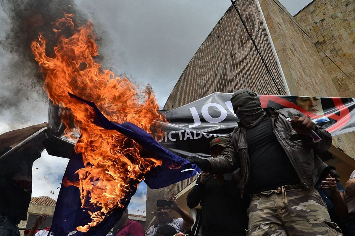 Students of the National Autonomous University of Honduras (UNAH) demonstrate demanding the resignation of Honduran President Juan Orlando Hernandez for his alleged links with drug trafficking, in the surroundings of the Congress building in Teguciga
