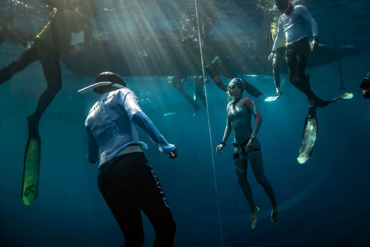 A photo released on August 8, 2019 shows Singaporean freediver Lim Anqi competing in the recent Caribbean Cup in Honduras. She came in third in the constant weight no fins discipline, diving to a depth of 47m and breaking her previous 45m record. PHO