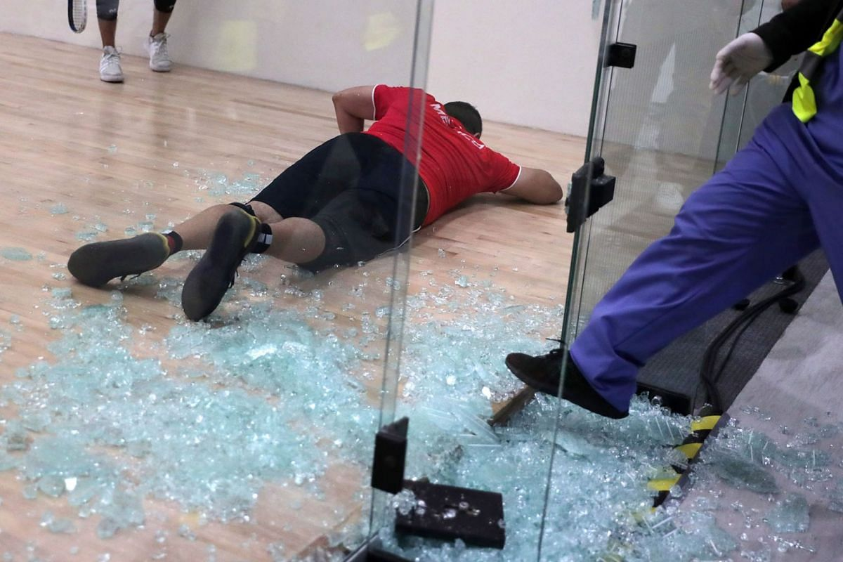 Mexico's Alvaro Beltran lies on the ground after breaking a glass panel of the racquetball court during his Gold Medal Match against Mexico's Rodrigo Montoya at the XVIII Pan American Games in Lima, Peru on August 7, 2019. PHOTO: REUTERS