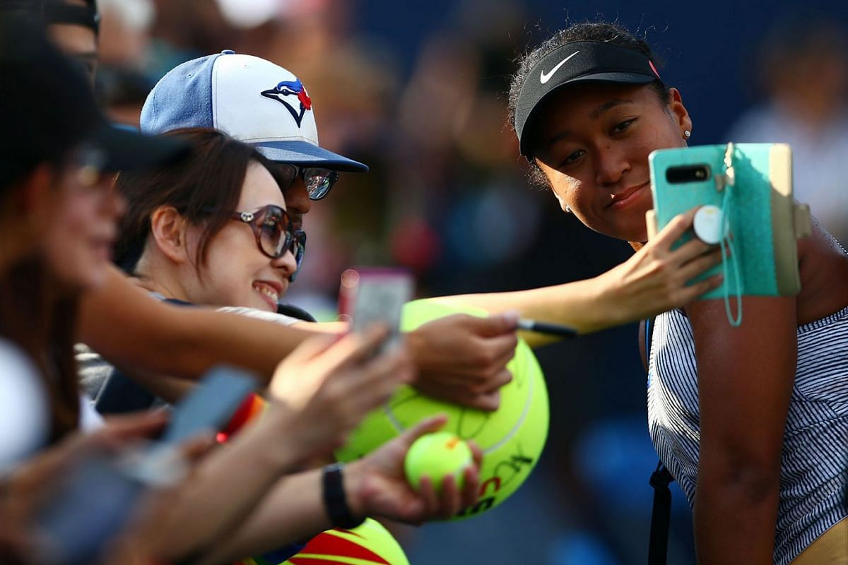 Naomi Osaka of Japan interacts with fans following a second round match victory over Tatjana Maria of Germany on Day 5 of the Rogers Cup at Aviva Centre on August 7, 2019 in Toronto, Canada. PHOTO: GETTY IMAGES/AFP