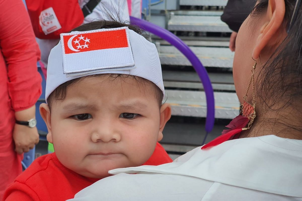 Ten-month-old Muhammad Sayf Khan arriving for his first National Day Parade at the Padang on Aug 9, 2019. This photo was captured with the Samsung Galaxy Note10+ using the zoom function.