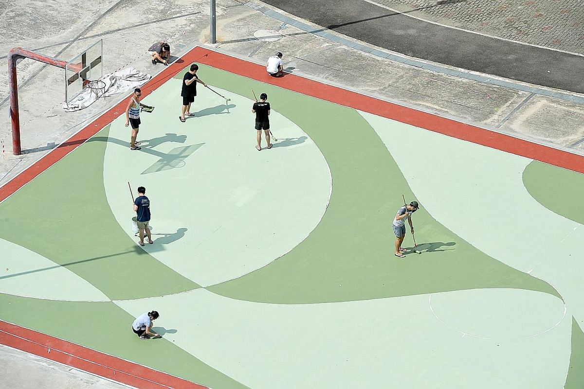 The team working on the painting at the basketball court on July 10. Mr Toby Tan started the project because he felt that Singaporeans were largely unaware of the meaning of neighbourhood names.