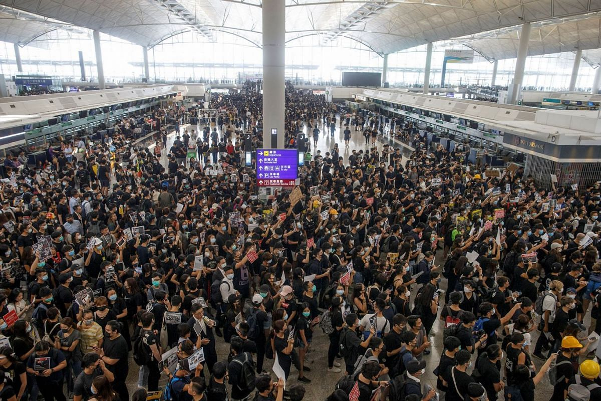 Anti-extradition bill protesters rally at the departure hall of Hong Kong airport in Hong Kong on Aug 12, 2019.