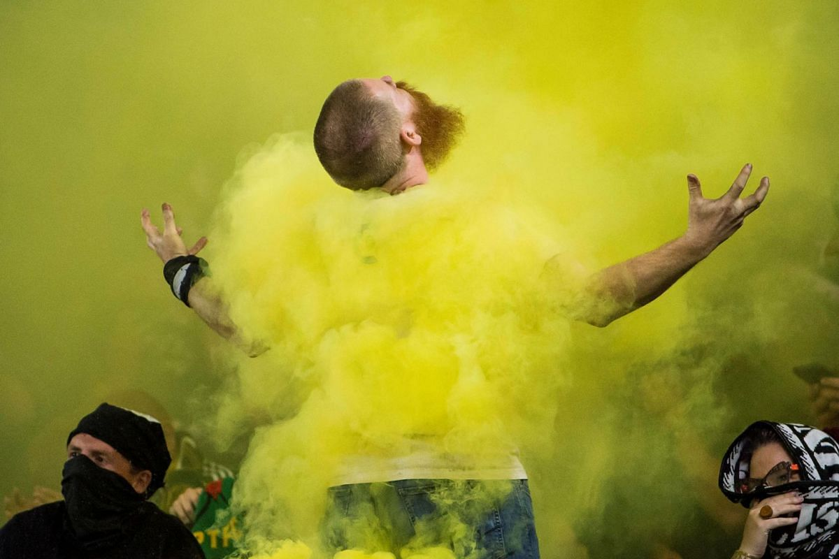 A Portland Timbers fan celebrates after a Timbers goal during the second half against the Vancouver Whitecaps at Providence Park, Aug 10, 2019, in Portland, Oregon, United States. The Timbers beat the Whitecaps 3-1.