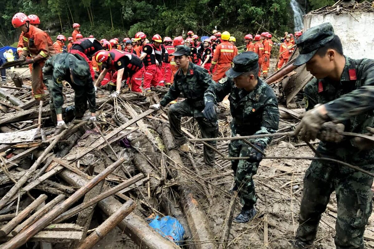 Rescuers working on the landslide triggered by Typhoon Lekima in Yongjia county, Zhejiang province, on Aug 11, 2019.