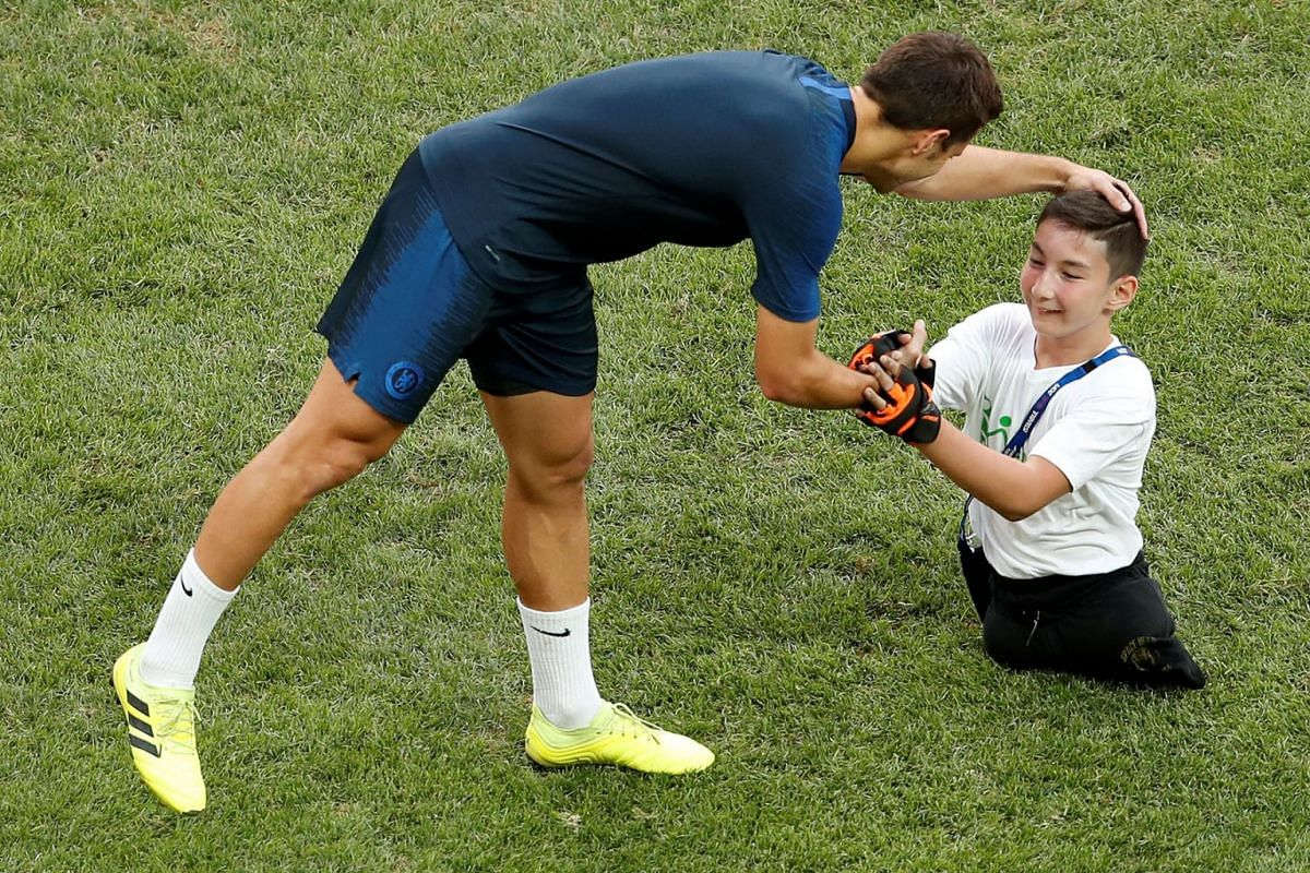 Chelsea's Cesar Azpilicueta chats with a child during training ahead of the UEFA Super Cup 2019 football match between Liverpool and Chelsea at Besiktas Park stadium in Istanbul on August 13, 2019. PHOTO: REUTERS