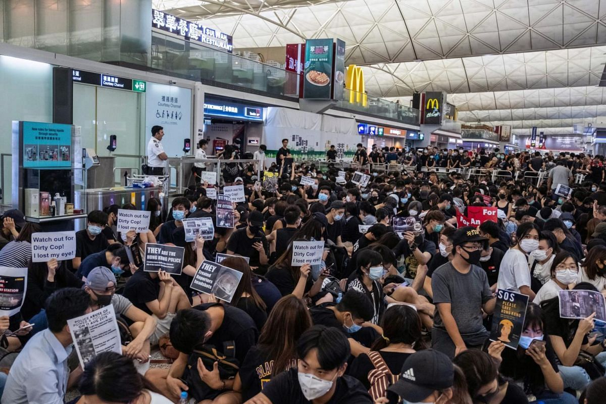 Protesters jam Hong Kong's international airport, on Aug 13, 2019.