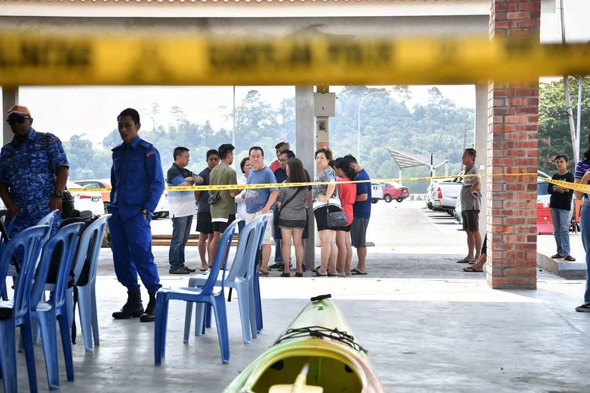 Relatives and friends of the missing kayakers at Penyabong Jetty in Mersing after a police news conference on August 14, 2019. The son of Madam Puah Geok Tin - one of two Singaporean kayakers who went missing in the Endau waters at Mersing last Thurs