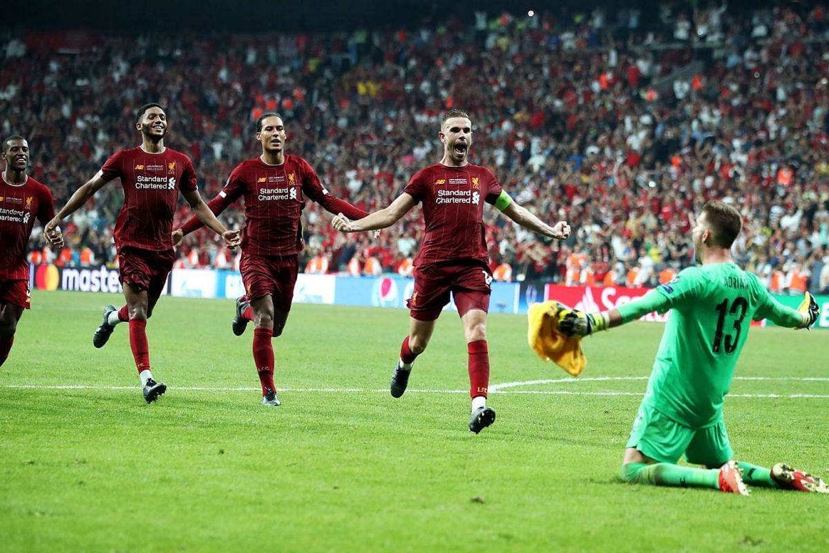 Liverpool goalkeeper Adrian (R) celebrates after the penalty shoot out during the UEFA Super Cup Final soccer match between Liverpool and Chelsea at Besiktas Park in Istanbul, Turkey on August 14, 2019. Liverpool beat Chelsea on penalties to take hom