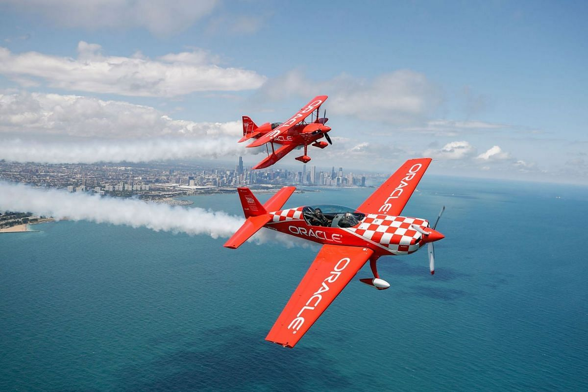 Team Oracle, Hall of Fame Air Show Performer Sean D. Tucker (top) and Jessy Panzer (bottom) fly their aircrafts over Chicago as they prepare for the 61th annual Chicago Air and Water Show on August 15, 2019 in Chicago, Illinois. PHOTO: AFP