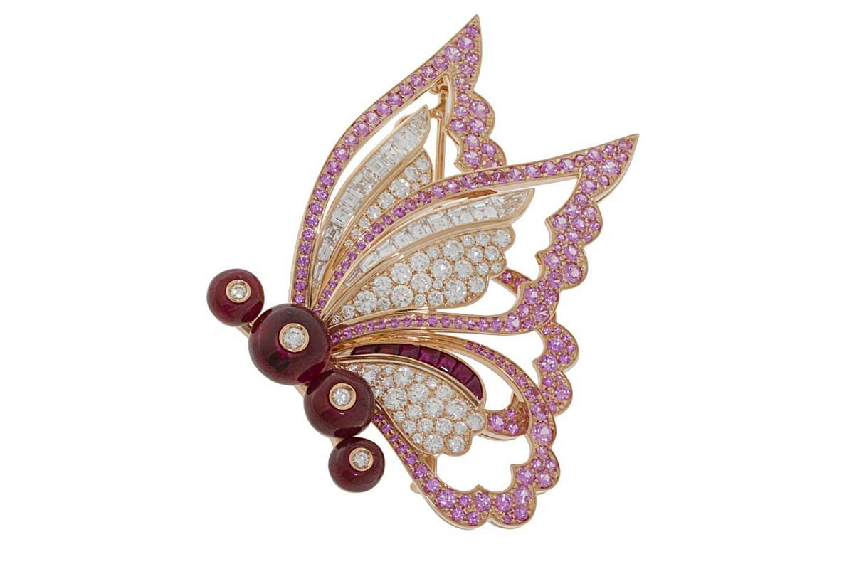 Inspired by Peter Pan's Tinkerbell, the Fairy Wings brooch in pink gold is embellished with four ruby beads, seven buff-top rubies, 19 step-cut diamonds as well as pave-set pink sapphires and pave-set diamonds.