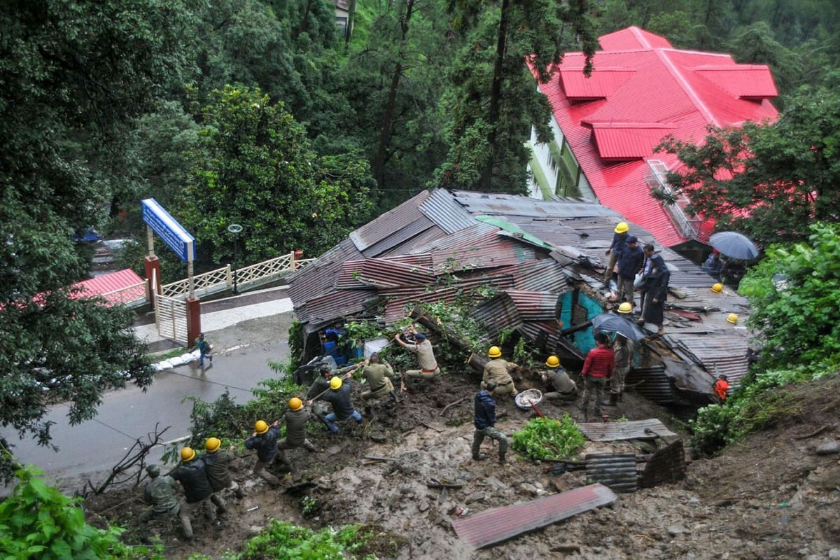 Rescuers work on a site after a building collapsed following heavy monsoon rainfall in the northern hill town of Shimla, India, on Aug 18, 2019.