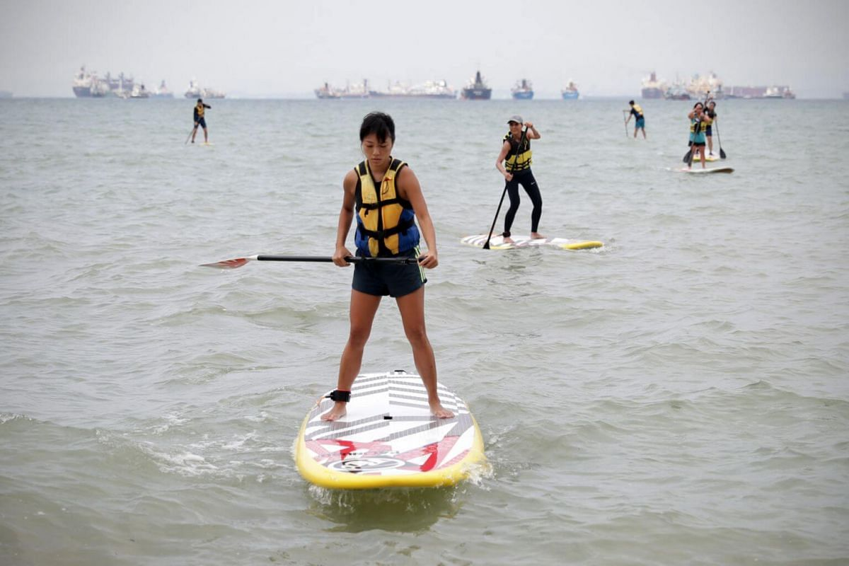 Ms Jessica Wee balances on the paddle board as she heads back to shore during a training session at East Coast Park.