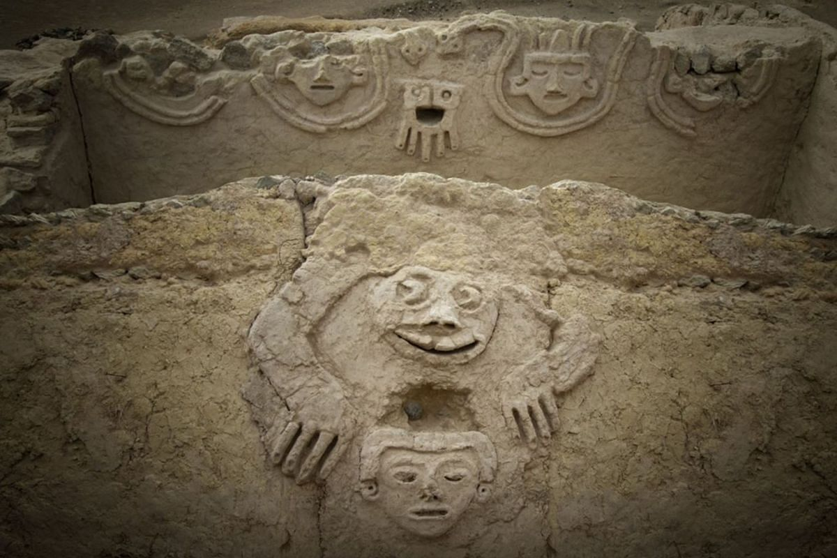 An undated handout photo made available by Archaeological Area Caral on August 19, 2019 shows a humanized toad and an anthropomorphic head, discovered in one of the buildings of the civilization of Caral, north of Lima, Peru. HANDOUT VIA EPA-EFE