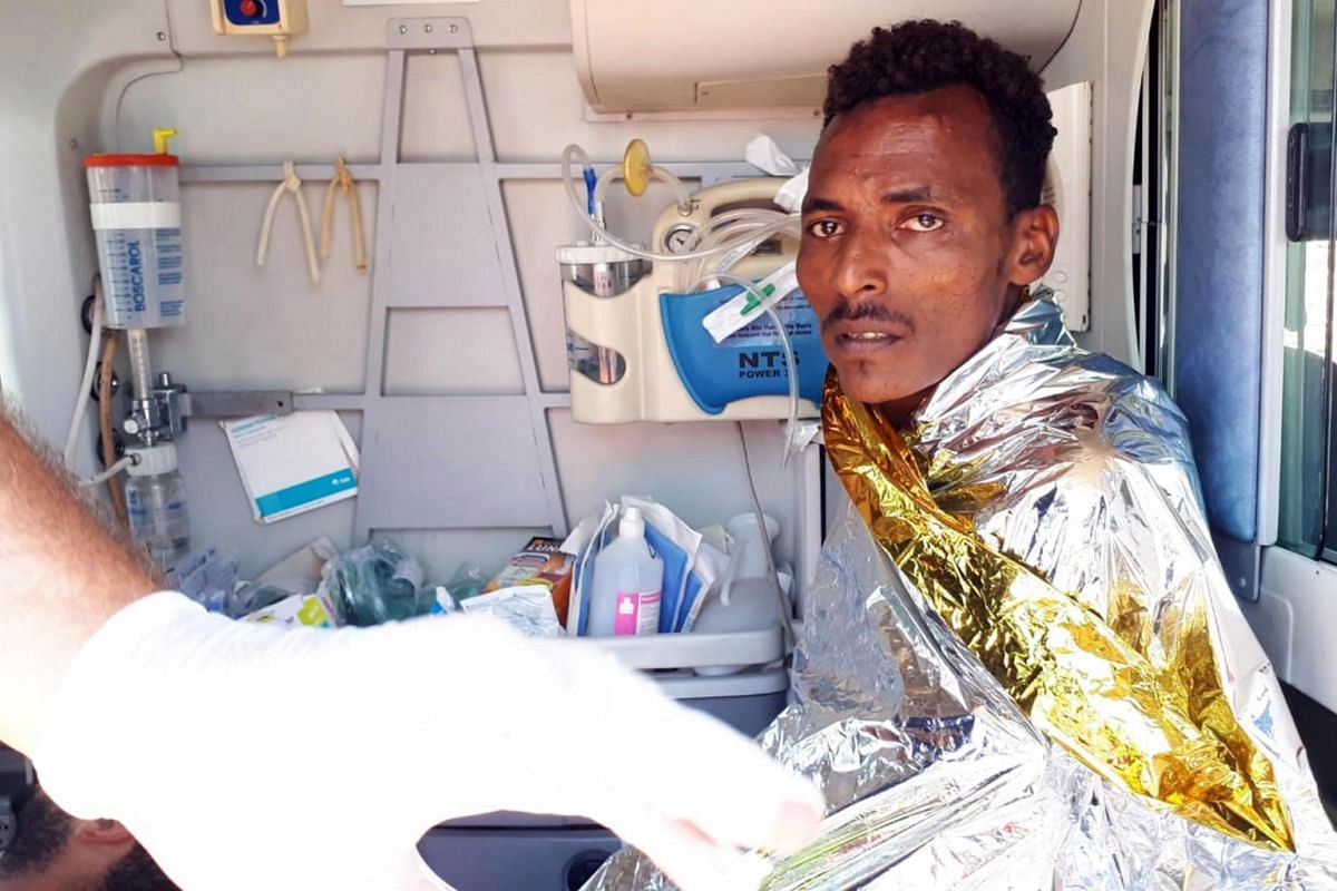 A migrant, who reportedly dived into the sea from Open Arms, a Spanish non-governmental organisation rescue ship, in an attempt to swim to the coast, aboard an ambulance on the Sicilian island of Lampedusa in southern Italy on Aug 20, 2019.