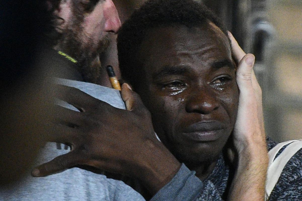 A migrant gets emotional as he leaves the Spanish rescue ship Open Arms.
