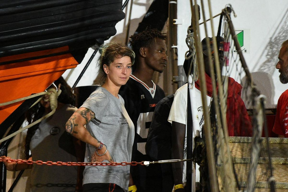 Ms Anabel Montes Mier, head of mission onboard the Spanish rescue ship Open Arms, looks on as the vessel arrives with migrants on the island of Lampedusa in Italy on Aug 20, 2019.