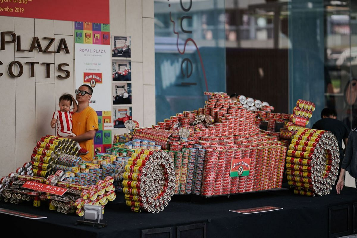 A race car sculpture made of Ayam Brand tin cans displayed at Royal Plaza on Scotts hotel in Singapore on August 21, 2019.