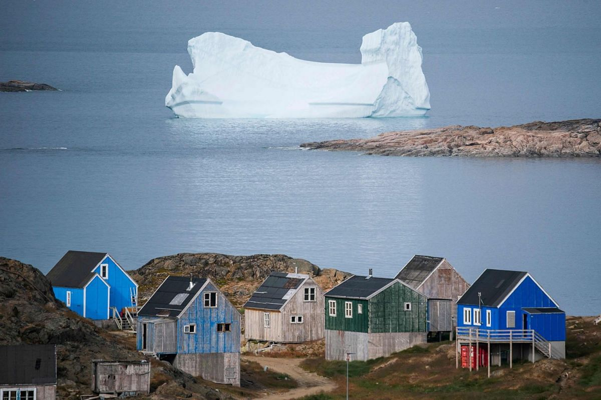 Icebergs float behind the town of Kulusuk in Greenland on August 19, 2019. PHOTO: AFP