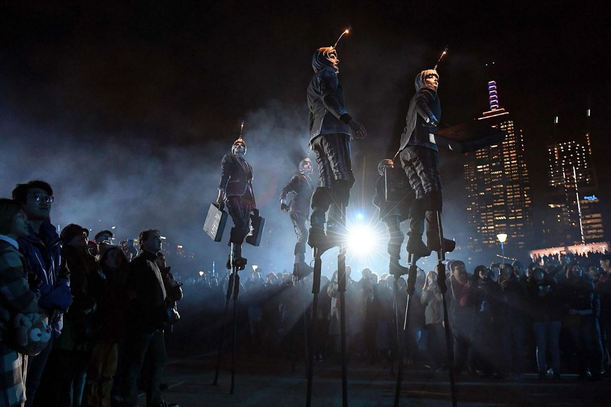 Performers on stilts from the Amsterdam street theatre troupe Close-Act entertain spectators during the White Night festival in Melbourne on August 22, 2019. PHOTO: AFP