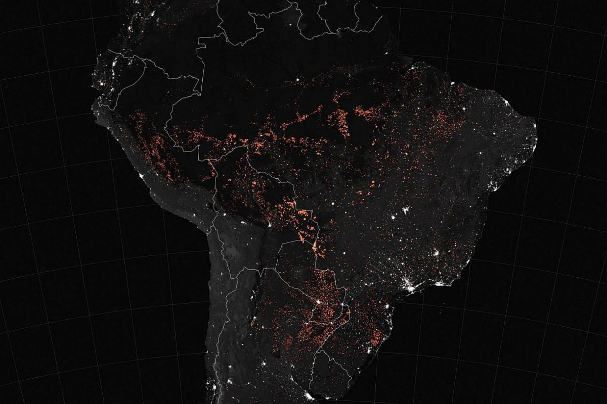 A handout Nasa Earth Observatory map shows active fire detections in South America, including Brazil, Bolivia, Peru, Paraguay, Ecuador, Uruguay, northern Argentina and north-western Colombia, as observed by Terra and Aqua satellites' MODIS instrument