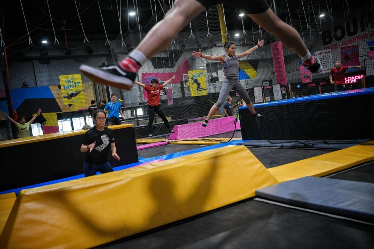 Healthcare worker Faezah Sani (right) takes part in a BounceFit session along with other participants at Bounce at Orchard Cineleisure, Singapore, on Aug 25, 2019.