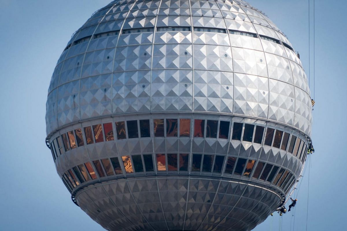 Workers on the dome of the iconic Berlin television tower, at a height of around 200m, on Aug 26, 2019.