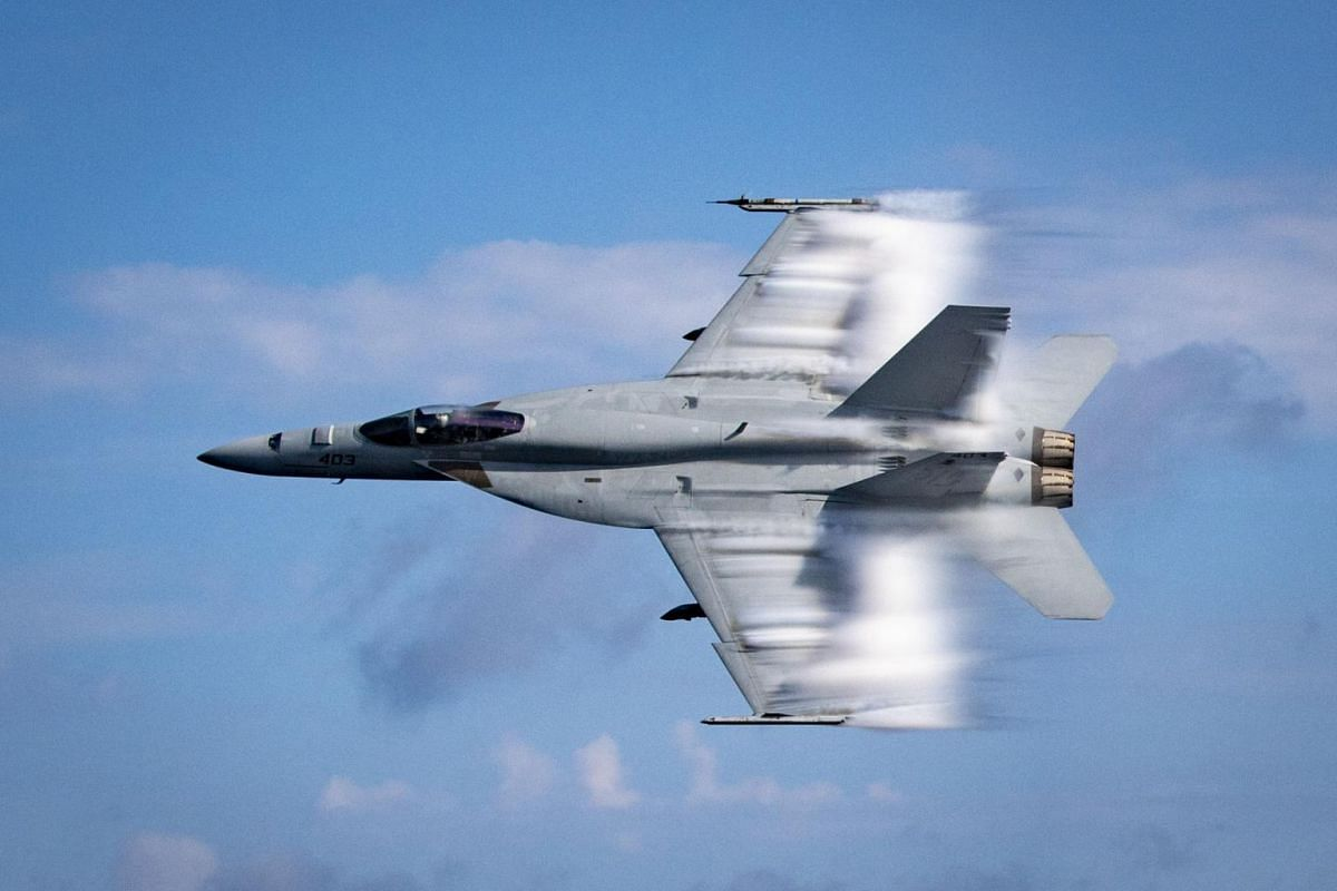An F/A-18E Super Hornet from the United States Navy conducting a supersonic pass during a training exercise on Aug 23, 2019.