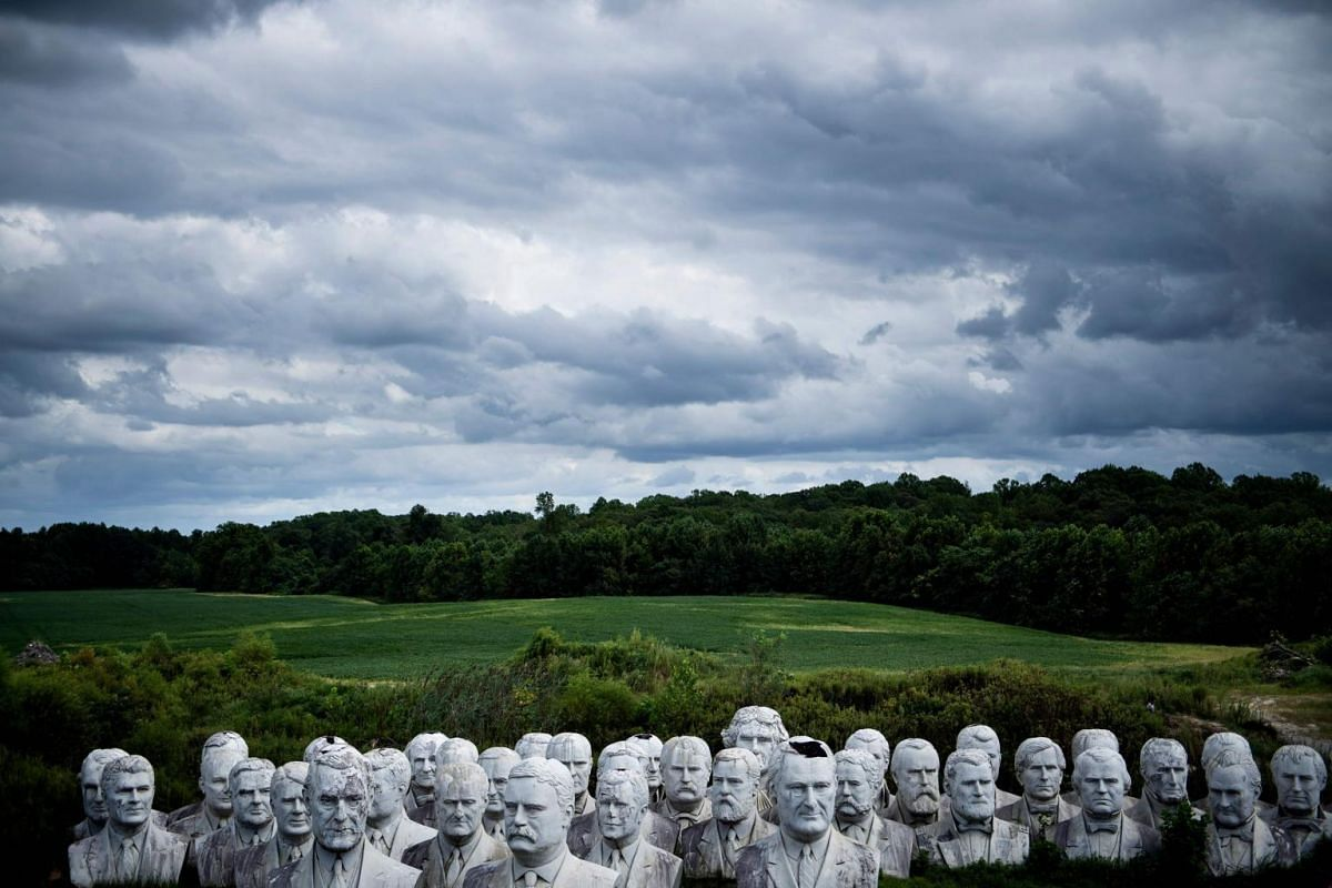 Salvaged busts of former United States presidents on a farmer's field in Williamsburg, Virginia, on Aug 25, 2019.