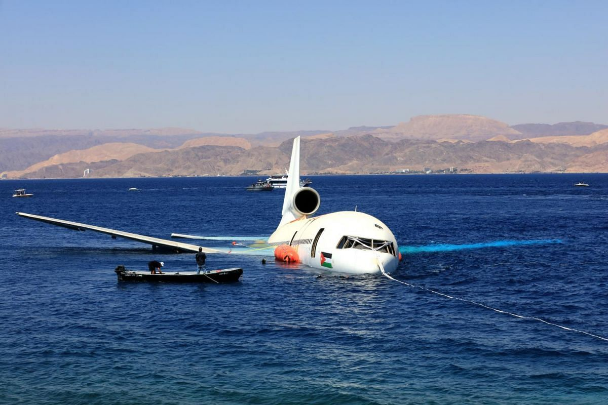 A disused Lockheed L-1011 Tristar being submerged into the waters of the Red Sea in Aqaba, Jordan, to create an artificial diving site on Aug 26, 2019.