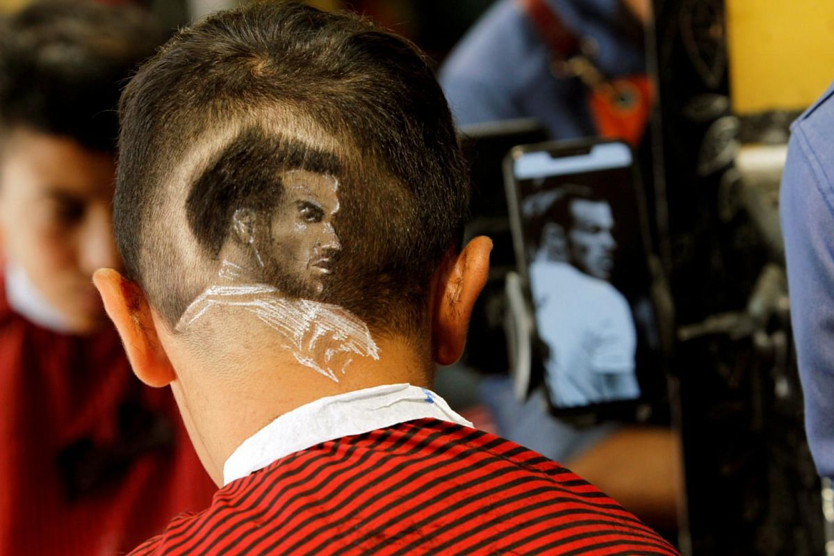 A portrait of famous football star Gareth Bale is etched on football-crazed youth Baland Mohammed's head at a barber shop in Halabja, Iraq, on Aug 22, 2019.