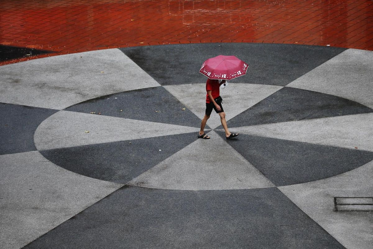 A man walks amid rainy weather at Bukit Merah Central, Singapore, on Aug 27, 2019.