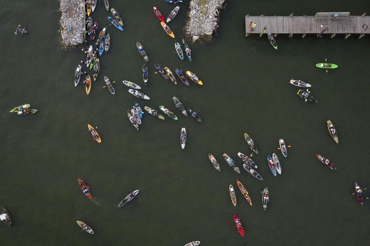Competitive fishermen and women launch into the water at the start of the Ride the Bull Kayak Tournament at Bridge Side Marina in Grand Isle, Louisiana, United States on Aug 24, 2019.