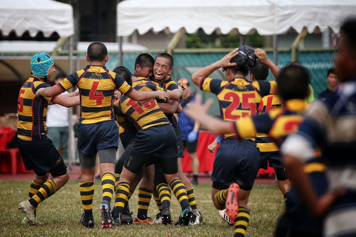 Tycen Yeoh (centre, facing camera) of ACS(I) celebrates with teammates as the final whistle blows and ACS(I) emerge victorious over St Andrew's in the Boys' C Division rugby finals at Queenstown Stadium on August 29, 2019. PHOTO: THE STRAITS TIMES/